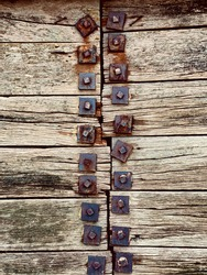 aged nautical style wooden panels with rusted metal bolts