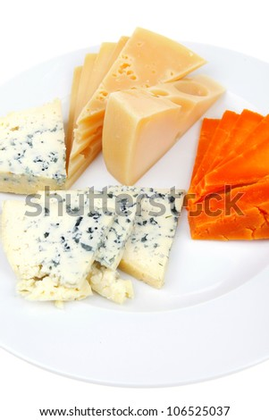 aged parmesan roquefort and gruyere chops delicatessen cheeses and slices on plate isolated over white background - stock photo