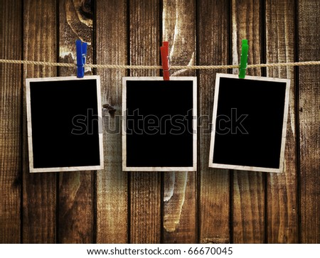 Aged photo frames on wood background