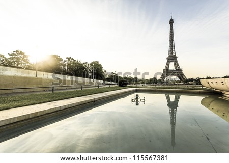 Aged photo of Eiffel Tower with reflection of water - stock photo