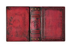 Aged red leather book cover with the embossed ancient Egyptian symbol