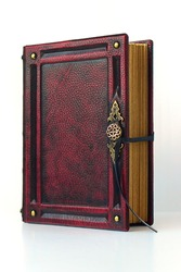 Aged red leather book with metal clasp as a door handle