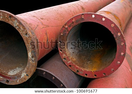 Aged rusty grunge industrial pipes close up.