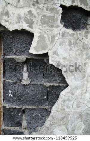 Aged slag stone wall with plaster come off