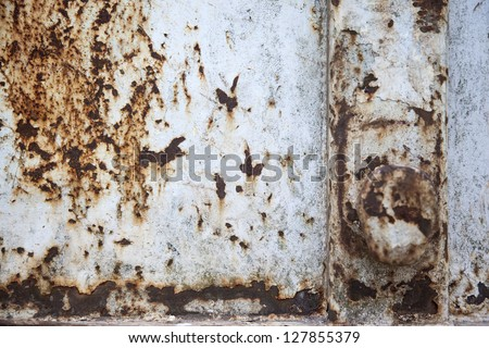 Aged steel container with grungy rust patterns. #127855379