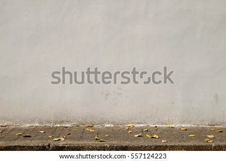 Aged street wall background #557124223