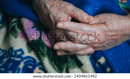 aged textured hands, arms of elderly lady. wrinkled skin of aged person. aging process. #1404861482