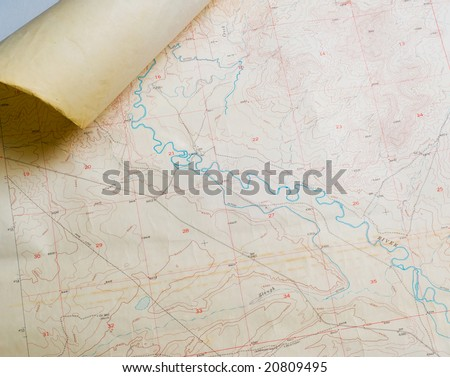 Aged topographical map with rolled corner