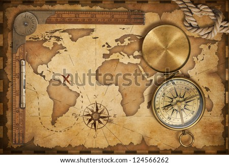 aged treasure map, ruler, rope and old brass compass with lid