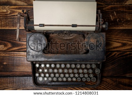 Aged typewriter with a blank paper #1214808031