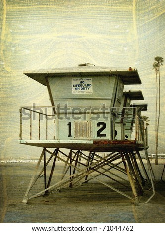 Aged vintage photo of lifeguard tower on beach