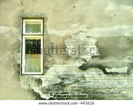 aged wall with a small window