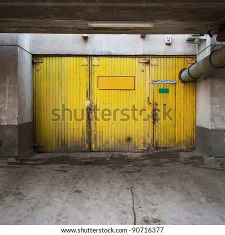 Aged warehouse exterior with doors.