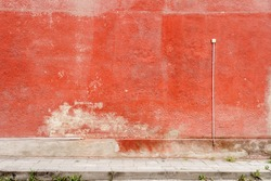 Aged weathered red street wall background