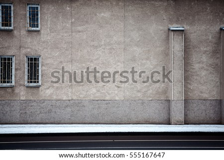 Aged weathered street wall with some windows