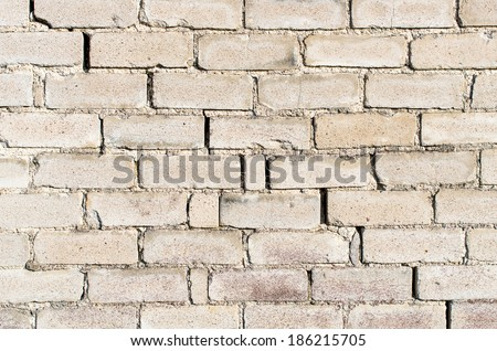 Aged white brick wall texture. Old white brick wall texture