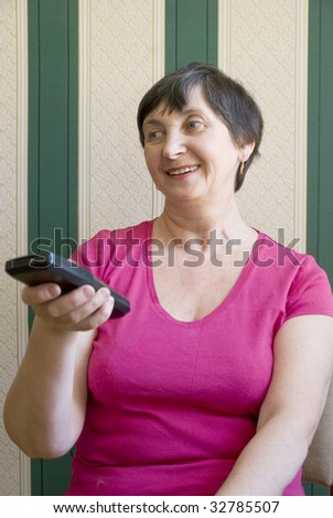 Aged woman changing channels