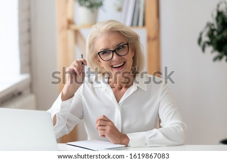 Aged woman company owner interviewing applicant at distant job interview, tutor teaches learner distantly. Businesswoman talk with client looks at pc screen, videoconferencing, video telephony concept