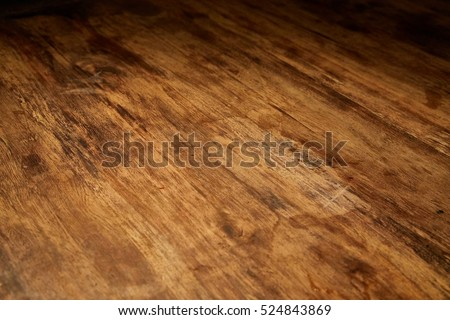 Aged wood desk in dim light #524843869