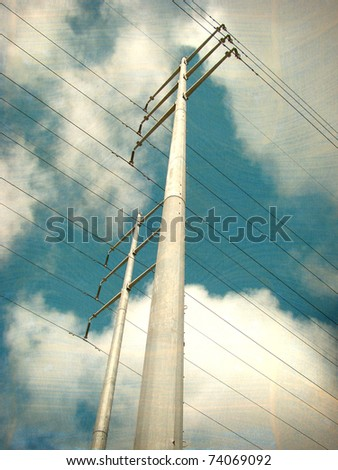 aged worn photo of high voltage electrical power pole and line against cloudy sky