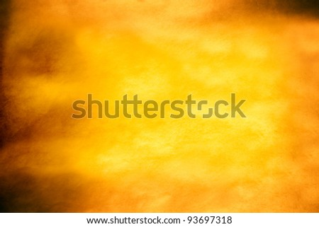 aged yellow parchment paper as grunge background