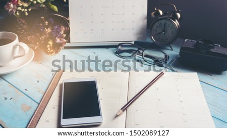 Agenda and mobile phone for Planner to plan timetable appointment organization management each date month and year, working online at home. Agenda and  2021 Calendar Concept. Stock photo ©
