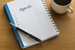 Agenda written on notebook with blank list, planning conceptual