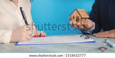 agent sells real estate to a young lady