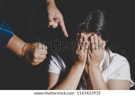 Aggression in the family, man beating up his wife. Domestic violence concept. Stock photo ©