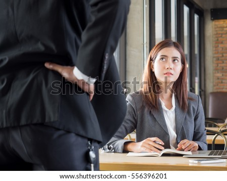 Aggressive/angry boss complaining asian business woman(casual uniform) in cafe office #556396201