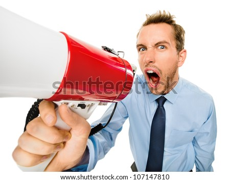 Aggressive businessman shouting with megaphone on white background
