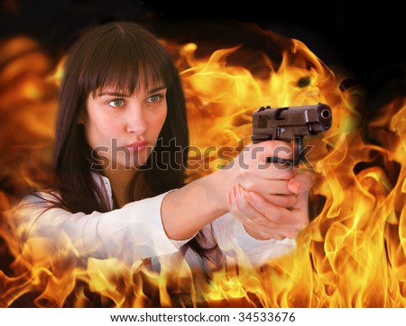 Aggressive girl shoots from flame. Collage.