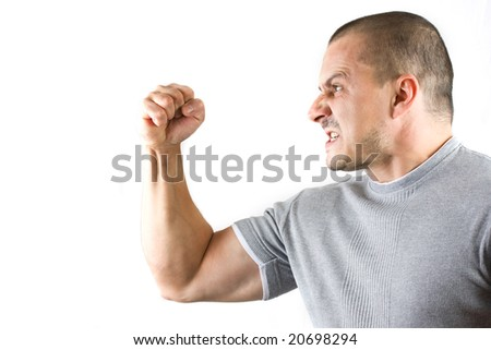 aggressive man showing his fist - stock photo