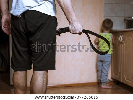 aggressive parent with belt and ...