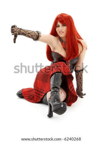 aggressive schoolgirl in black latex boots showing thumbs down