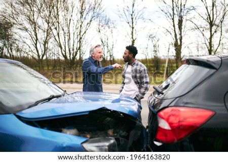 Aggressive senior male driver arguing over blame for car accident with a younger male motorist Сток-фото ©