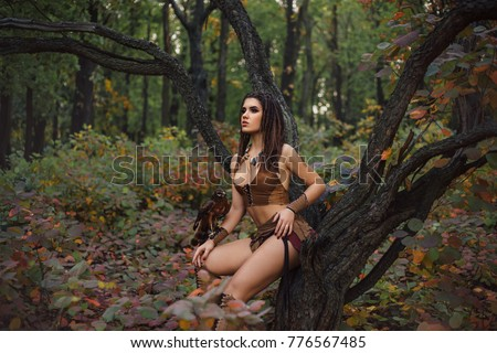Aggressive-sexual wild girl, wanders in the jungle with a tamed bird. Artistic Photography #776567485