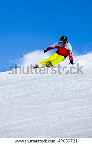 Aggressive skier in the snow powder turning left