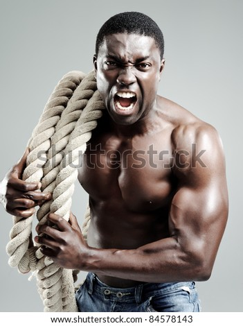 Aggressive well toned black man with rope