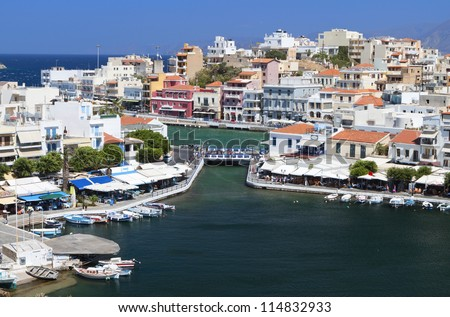 Aghios Nikolaos city at Crete island in Greece. View of the harbor - stock photo
