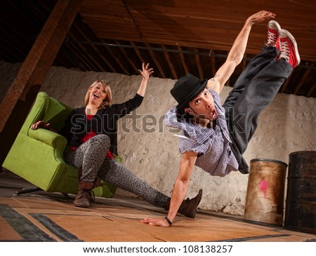 Agile young male break dancer leaping up
