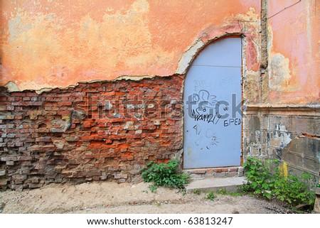 aging door in destroyed building