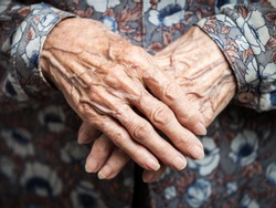Aging process - very old senior woman hands wrinkled skin