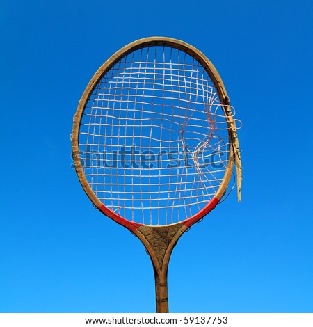 aging racket on celestial background