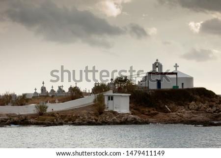 Photo of  Agios Fokas near Monemvasia in stormy weather overcast sky. Small cemetery on sea shore, Maleas peninsula region Peloponnese