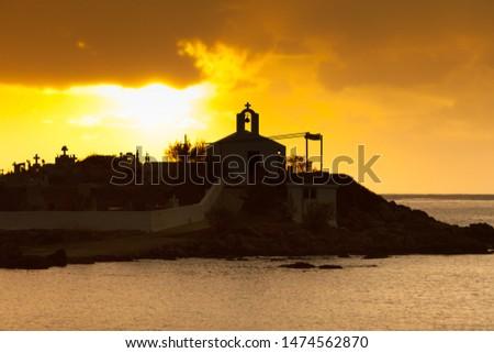 Photo of  Agios Fokas near Monemvasia in stormy weather overcast sky, sunrise. Small cemetery on sea shore, Maleas peninsula region Peloponnese