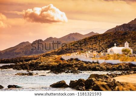Photo of  Agios Fokas near Monemvasia. Small cemetery graveyard on sea shore in Laconia region Peloponnese.