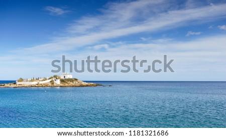 Photo of  Agios Fokas region of Monemvasia. Greek coastline with small cemetery on sea shore, Maleas peninsula region Peloponnese