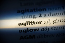 aglitter word in a dictionary. aglitter concept, definition.