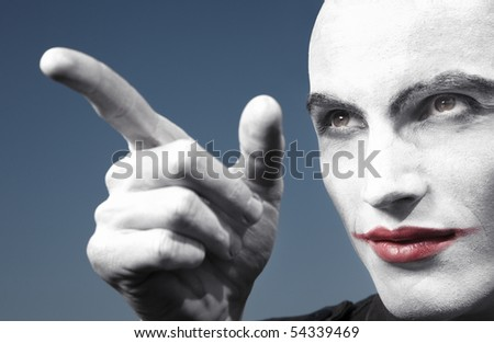 Agnry clown outdoors pointing finger. Horizontal photo